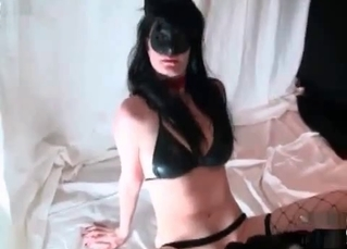 Masked brunette is collecting dog semen with love