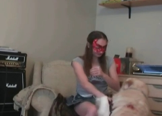 Masked slut is playing with a trained dog