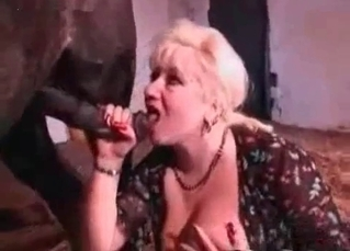 Blonde with huge boobs blows a horse dick